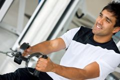 Man at the gym - weights Royalty Free Stock Photo