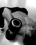 Man in gym working out. Man working out in the gym taken from an unusual angle Stock Photography