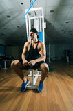 Man in gym. Young adult man is sitting in gym Royalty Free Stock Photo