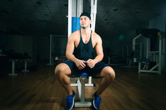 Man in gym. Young adult man is sitting in gym Stock Photo