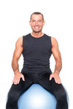 Man on gymnastic ball Stock Image