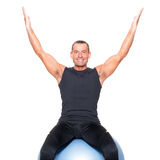 Man on gymnastic ball Royalty Free Stock Image