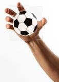 Man hållande övre ett tecken av en fotbollboll arkivbilder