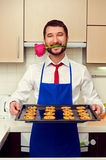 Man had baked festive cookies for his woman Royalty Free Stock Image