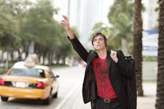 Man hailing a cab Royalty Free Stock Images