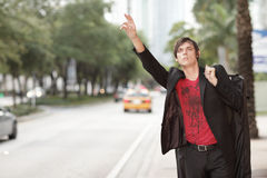 Man hailing a cab Stock Photos