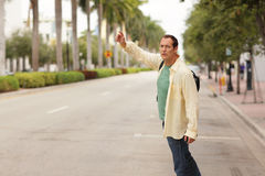 Man hailing a cab Stock Image