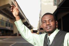 Man hailing a cab Royalty Free Stock Photography
