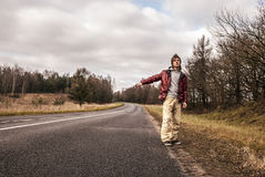 Man Hailing on a roadside of the road Stock Photography