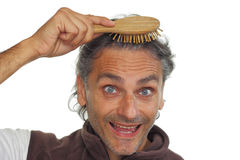Man with hair brush Royalty Free Stock Images