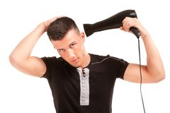 Man with a hair dryer Royalty Free Stock Photos
