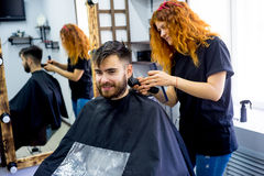 Man at a hair salon. A portrait of a men at a hair salon royalty free stock photography