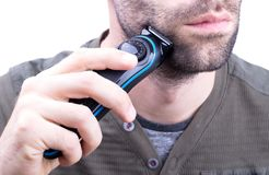 Man with hair trimmer. Beard and hair clippers royalty free stock photography