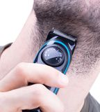 Man with hair trimmer. Beard and hair clippers stock photo