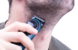 Man with hair trimmer. Beard and hair clippers stock image