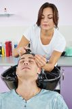 Man hair washing in hairdressing salon Royalty Free Stock Photos