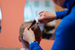 Man haircut at the barber scissors Royalty Free Stock Images