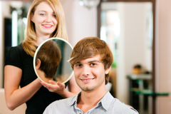 Man at the hairdresser Royalty Free Stock Image