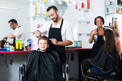 Man hairdresser and boy client Stock Images