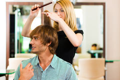 Man at the hairdresser Stock Image