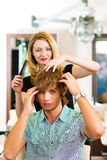 Man at the hairdresser Stock Photography