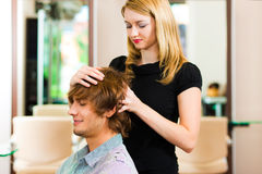 Man at the hairdresser Stock Photos