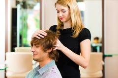 Man at the hairdresser Stock Photos