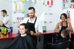 Man hairdresser and woman client Royalty Free Stock Photos