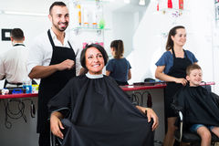 Man hairdresser and woman client Stock Photos