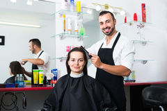 Man hairdresser and woman client Royalty Free Stock Photography