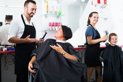Man hairdresser and woman client Royalty Free Stock Image