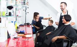 Man hairdresser and woman client Stock Photography