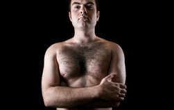 Man with hairy chest isolated on black background Stock Photos
