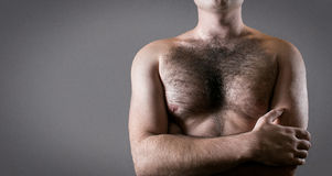 Man with hairy chest isolated on gray background for text. Royalty Free Stock Photos
