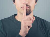 Man with half beard and finger on lips Stock Images