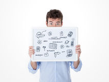 Man with half face behind a board with technologic sketches Stock Image