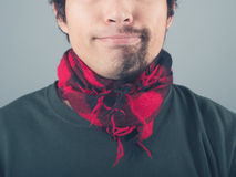 Man with half shaved beard wearing scarf Royalty Free Stock Photos