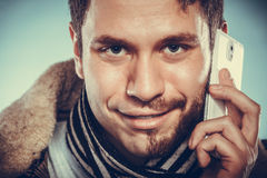 Man with half shaved face talking on mobile phone. Royalty Free Stock Images