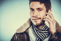 Man with half shaved face talking on mobile phone. Royalty Free Stock Photo