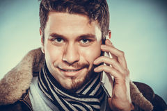 Man with half shaved face talking on mobile phone. Royalty Free Stock Image