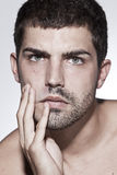 Man is half shaved posing Stock Images