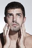 Man is half shaved posing Stock Image