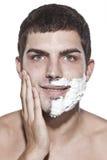 Man is half shaved posing Stock Photo