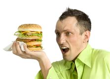 Man with hamburger Royalty Free Stock Photos