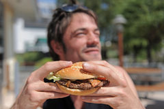 Man and hamburger Royalty Free Stock Photos