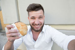 Man with hamburger Stock Photo