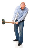 Man with hammer in action Royalty Free Stock Images