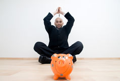 Man with hammer and bank Stock Photo