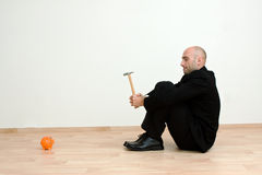 Man with hammer and bank Stock Images