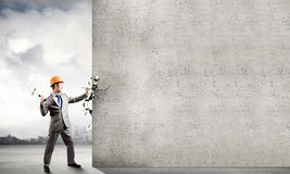Man with hammer Stock Photography